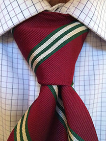 Custom designed ties by Barnard-Maine, Ltd tied iinto a Windsor Knot.